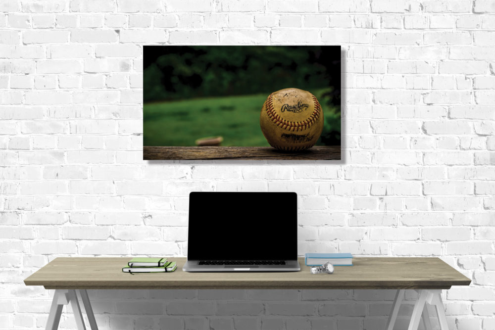 baseball with green canvas on wall