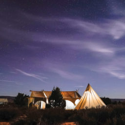 Photograph of tents under the stars